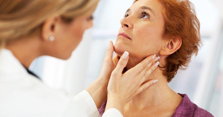 female doctor examining her senior woman patient