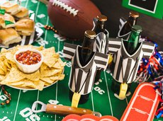 Superbowl decorated table with snacks and beer