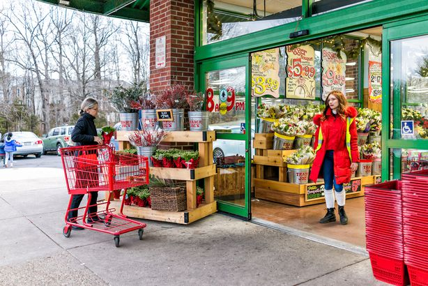 Trader Joe's employee in red clothes with customer