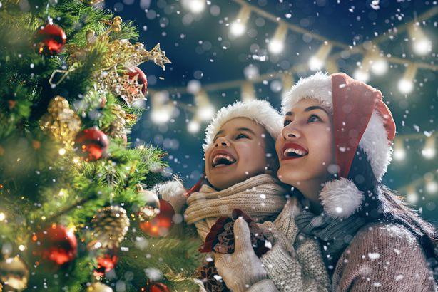 mother and child enjoying Christmas outside