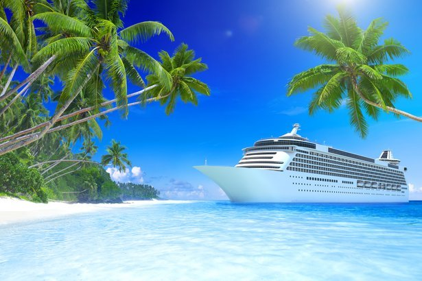 cruise ship docked at tropical beach