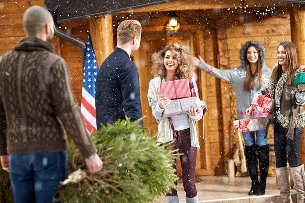 women welcome guests for Christmas holidays
