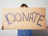 woman holding donation sign
