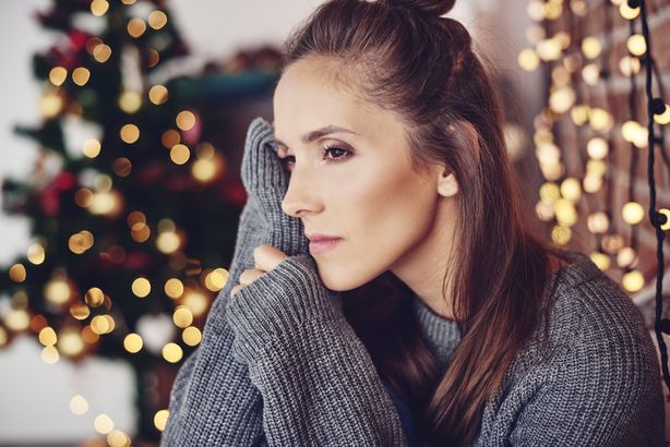 woman thinking and worrying at home during the holidays