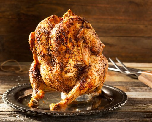 rotisserie chicken standing up on table