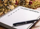 New Year's resolutions on a wooden table with colorful decorations