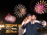 couple take a selfie for the new year with fireworks in background