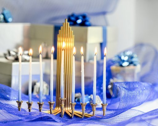 Chanukah decorations in blue and silver with gifts and dreidels