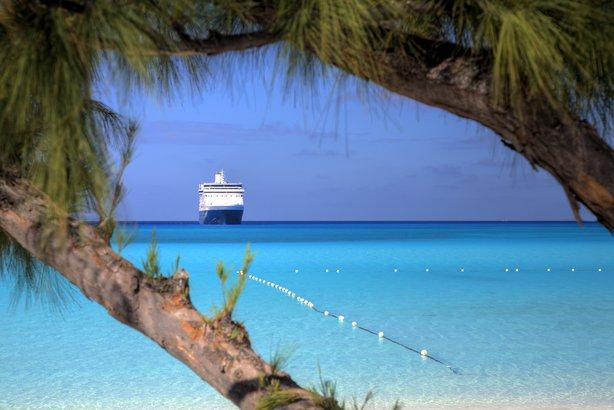 cruise ship approaching dock in Caribbean