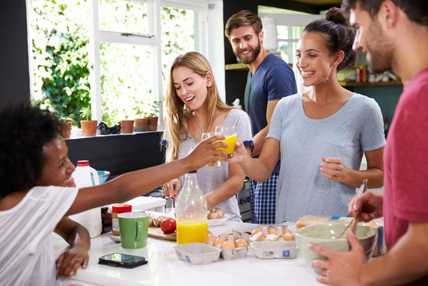 Group of friends having a breakfast party