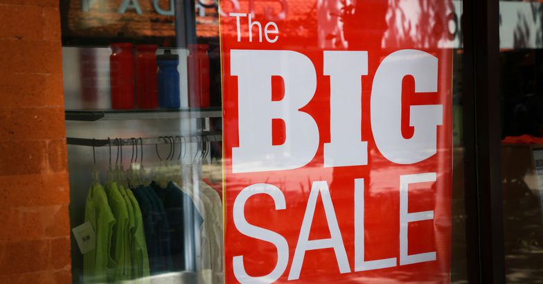 'The Big Sale' sign in store window