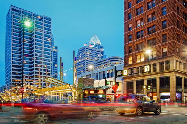 colorful urban scene with traffic in Downtown Cincinnati