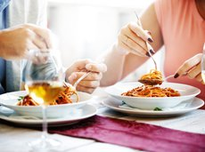 couple eating spaghetti at Italian restaurant