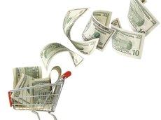 dollars falling in a shopping cart