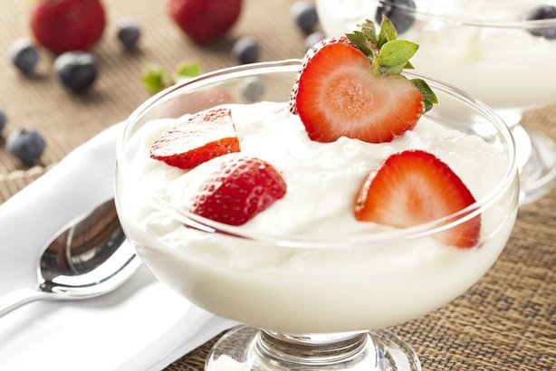 greek yogurt in glass bowl with strawberries
