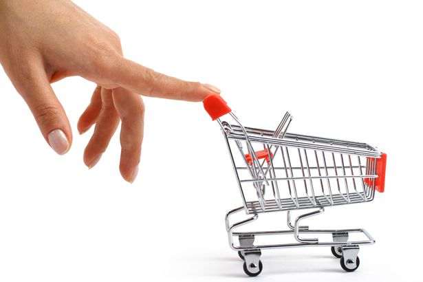 small shopping cart been pushed by hand