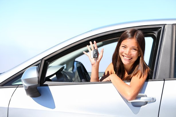 car driver woman smiling showing new car keys and car