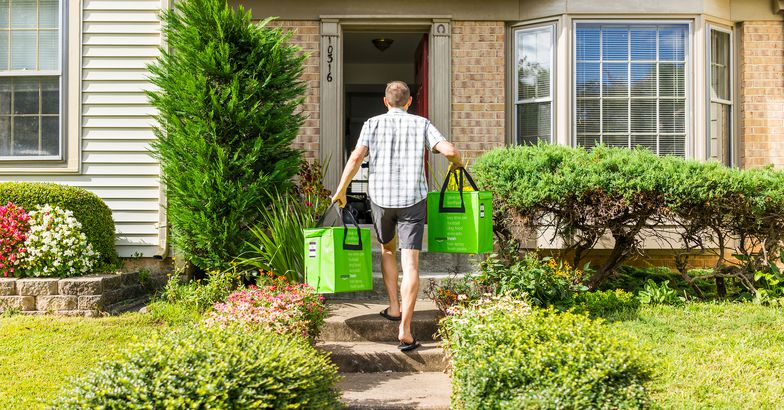 Amazon Fresh insulated grocery delivery bags totes man carrying to front door