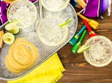 lime margaritas on the rocks against Cinco de Mayo
