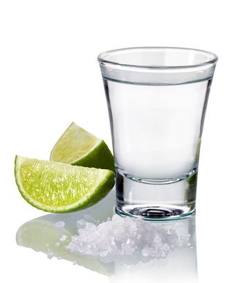 blanco tequila shot with fresh lime and salt