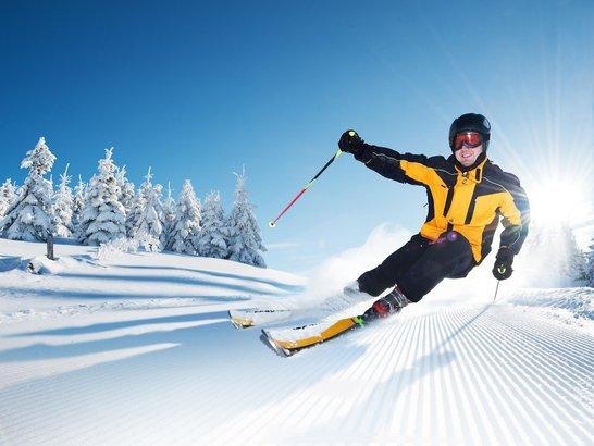 man skiing on slope