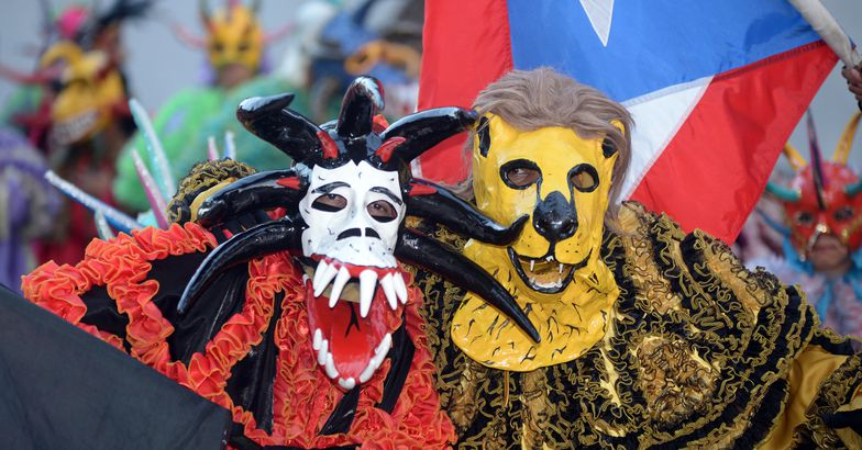 people in costumes and masks at ponce carnival, 2016