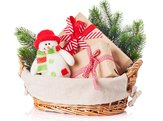 Christmas gift boxes, snowman toy, fir tree in basket