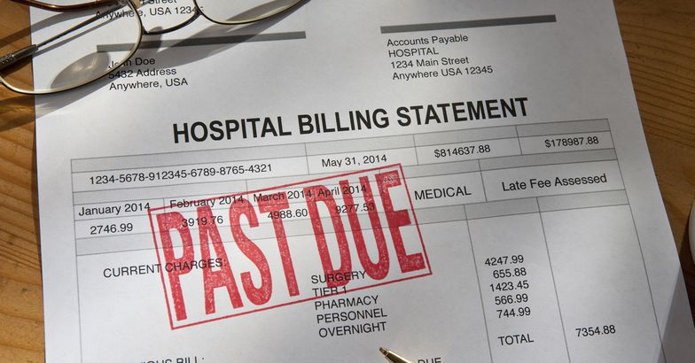 hospital billing statement with past due stamped on the invoice
