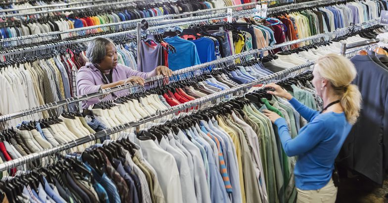 two women working in clothing goodwill store
