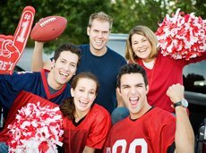 group of excited football fans cheering for their team while tailgating