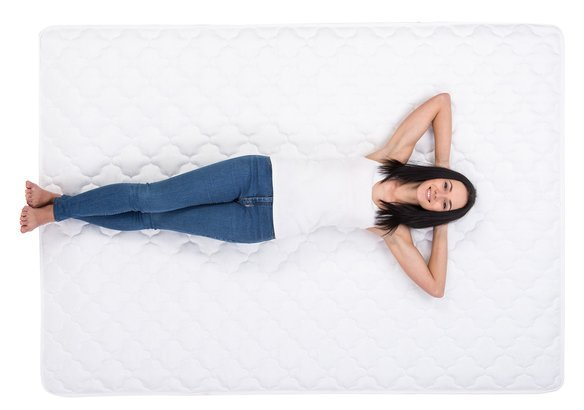 woman laying on mattress