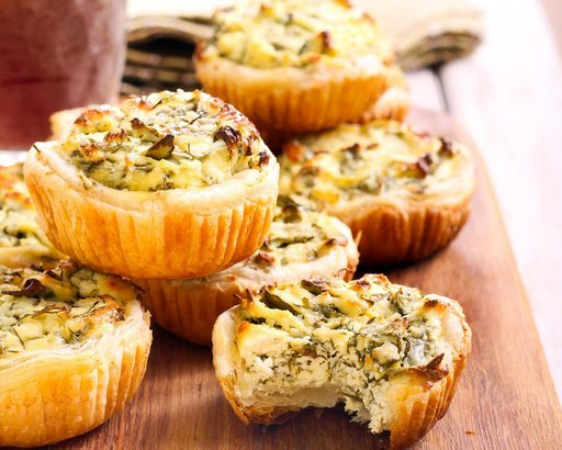 cheese and spinach mini pies on board