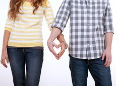 heart shaped hands of couple in love