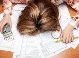 woman collapsed, frustrated with tax forms