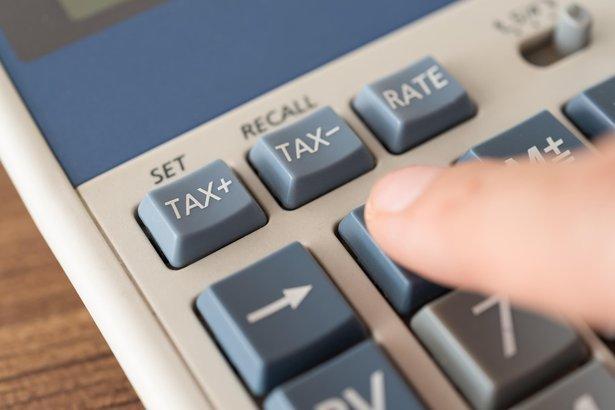 finger on calculator