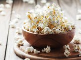 popcorn in bowl on table