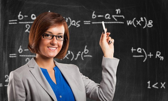 female teacher and blackboard