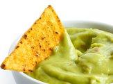 tortilla chip in guacamole