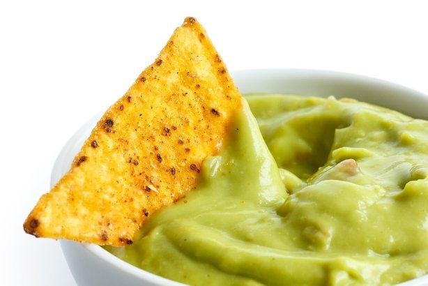 tortilla chip in guacamole