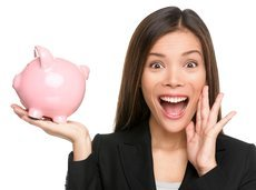 woman holding piggy bank screaming and shouting excited