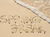 'Spring Break' written in the sand on the beach