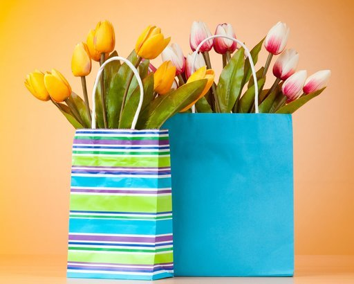 two shopping bags with flowers