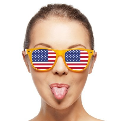 funny teenage girl in sunglasses with American flag