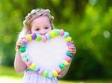 little girl holding easter decoration outside