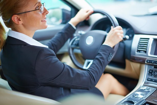 woman driving a car to work