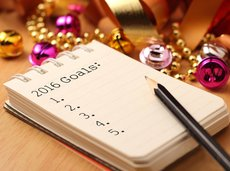 New Year's goals on spiral notebook with colorful decorations