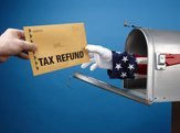 Uncle Sam's arm comes through mailbox to give/take tax refund