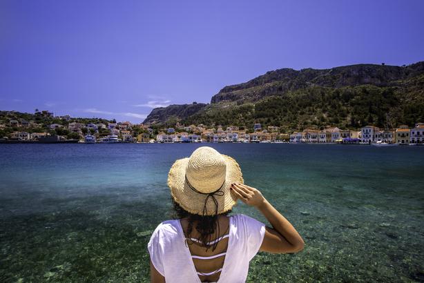 Woman looking across the sea in Greece