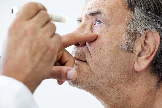 Closeup of man being examined by a doctor