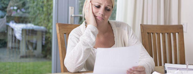 Woman Looking at Bills